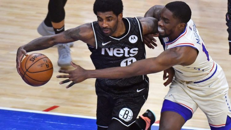 Apr 14, 2021; Philadelphia, Pennsylvania, USA; Brooklyn Nets guard Kyrie Irving (11) and Philadelphia 76ers guard Shake Milton (18) battle for the ball during the second quarter at Wells Fargo Center. Mandatory Credit: Eric Hartline-USA TODAY Sports