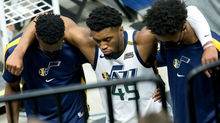 Apr 16, 2021; Salt Lake City, Utah, USA; Utah Jazz guard Donovan Mitchell (45) is helped off the court after suffering an apparent injury during the second half against the Indiana Pacers at Vivint Smart Home Arena. Mandatory Credit: Russell Isabella-USA TODAY Sports