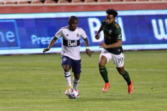 Apr 18, 2021; Sandy, Utah, USA; Vancouver Whitecaps FC forward Deiber Caicedo (7) plays the ball while defended by Portland Timbers midfielder Eryk Williamson (19) during the first half at Rio Tinto Stadium. Mandatory Credit: Rob Gray-USA TODAY Sports