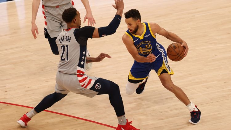 Apr 21, 2021; Washington, District of Columbia, USA; Golden State Warriors guard Stephen Curry (30) drives to the basket past Washington Wizards center Daniel Gafford (21) in the fourth quarter at Capital One Arena. Mandatory Credit: Geoff Burke-USA TODAY Sports