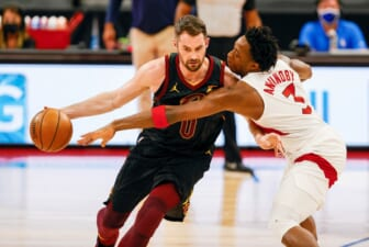Apr 26, 2021; Tampa, Florida, USA; Toronto Raptors forward OG Anunoby (3) attempts to steal the ball from Cleveland Cavaliers forward Kevin Love (0) in the first quarter at Amalie Arena. Mandatory Credit: Nathan Ray Seebeck-USA TODAY Sports