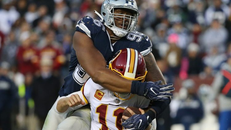 Oct 21, 2018; Landover, MD, USA; Washington Redskins quarterback Alex Smith (11) is tackled by Dallas Cowboys defensive tackle David Irving (95) in the fourth quarter at FedEx Field. Mandatory Credit: Geoff Burke-USA TODAY Sports