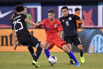 Sep 6, 2019; East Rutherford, NJ, USA; United States midfielder Christian Pulisic (10) drives the ball against Mexico midfielder Erick Guti rrez (25) during the second half during an international friendly soccer match at MetLife Stadium. Mandatory Credit: Dennis Schneidler-USA TODAY Sports