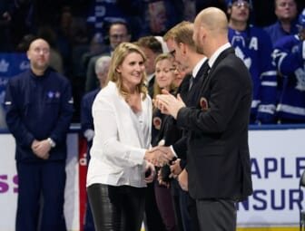 Nov 15, 2019; Toronto, Ontario, CAN; Class of 2019 Hockey Hall of Fame inductee Hayley Wickenheiser shakes hands with hall of famers prior to a game between the Boston Bruins and Toronto Maple Leafs at Scotiabank Arena. Mandatory Credit: John E. Sokolowski-USA TODAY Sports