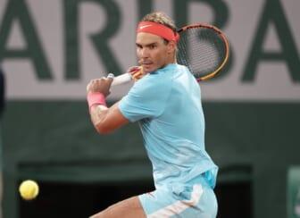 Oct 11, 2020;  Paris, France; Rafael Nadal (ESP) in action during his match against Novak Djokovic (SRB) on day 15 at Stade Roland Garros. Mandatory Credit: Susan Mullane-USA TODAY Sports