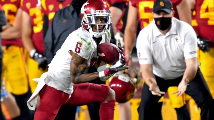 Dec 6, 2020; Los Angeles, California, USA;     Washington State Cougars wide receiver Jamire Calvin (6) catches a pass for a first down in the second half of the game against the USC Trojans at United Airlines Field at the Los Angeles Memorial Coliseum. Mandatory Credit: Jayne Kamin-Oncea-USA TODAY Sports