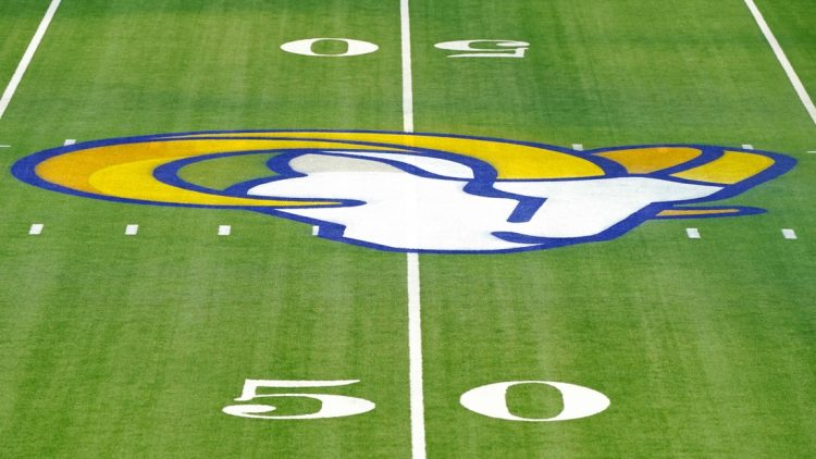 Jan 3, 2021; Inglewood, California, USA; A detailed view of a Los Angeles Rams logo at the 50-yard line before a game against the Arizona Cardinals at SoFi Stadium. Mandatory Credit: Kirby Lee-USA TODAY Sports