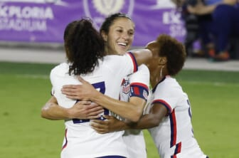 Jan 22, 2021; Orlando, Florida, USA;  United States forward Carli Lloyd (10) gets a congratulations from defender Margaret Purce (23) and midfielder Lindsey Horan (9) following her goal against Colombia during the second half at Exploria Stadium. Mandatory Credit: Reinhold Matay-USA TODAY Sports