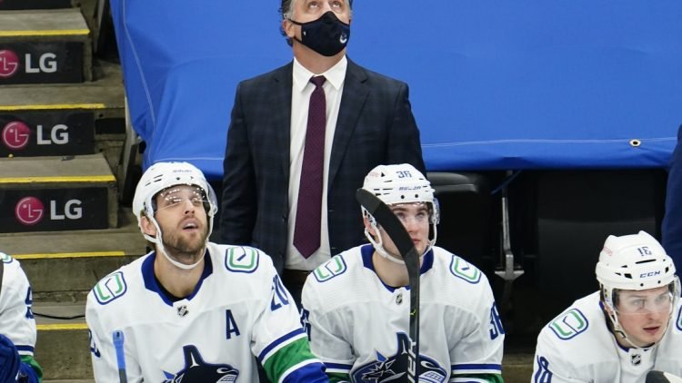Feb 4, 2021; Toronto, Ontario, CAN; Vancouver Canucks head coach Travis Green looks up at the scoreboard during the third period against the Toronto Maple Leafs at Scotiabank Arena. Toronto defeated Vancouver. Mandatory Credit: John E. Sokolowski-USA TODAY Sports