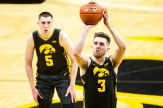 Iowa guard Jordan Bohannon (3) makes a free throw during a NCAA Big Ten Conference men's basketball game against Wisconsin, Sunday, March 7, 2021, at Carver-Hawkeye Arena in Iowa City, Iowa.  210307 Wisc Iowa Mbb 040 Jpg