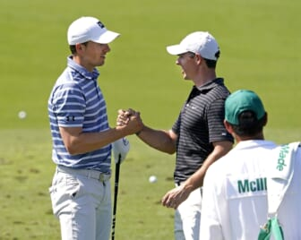 Apr 5, 2021; Augusta, Georgia, USA; Rory McIlroy congratulates Jordan Spieth (left) after winning the Valero Texas Open yesterday as they prepare for The Masters golf tournament at Augusta National Golf Club. Mandatory Credit: Rob Schumacher-USA TODAY Sports