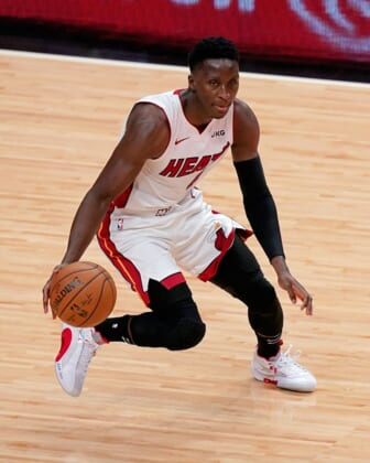Apr 6, 2021; Miami, Florida, USA; Miami Heat guard Victor Oladipo (4) dribbles the ball up the court against the Memphis Grizzlies during the first half at American Airlines Arena. Mandatory Credit: Jasen Vinlove-USA TODAY Sports