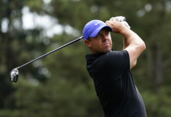 Apr 8, 2021; Augusta, Georgia, USA; Rory McIlroy hits his tee shot on the 18th hole during the first round of The Masters golf tournament. Mandatory Credit: Michael Madrid-USA TODAY Sports