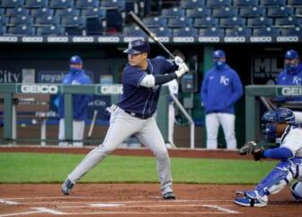 Apr 20, 2021; Kansas City, Missouri, USA; Tampa Bay Rays first baseman Yoshi Tsutsugo (25) at bat in the first inning against the Kansas City Royals at Kauffman Stadium. Mandatory Credit: Denny Medley-USA TODAY Sports