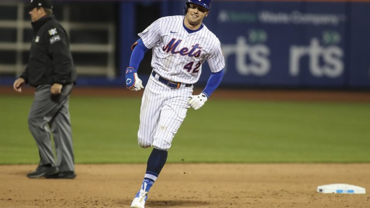 Apr 23, 2021; New York City, New York, USA; New York Mets center fielder Brandon Nimmo rounds second base in the eighth inning after hitting a home run against the Washington Nationals at Citi Field. Mandatory Credit: Wendell Cruz-USA TODAY Sports