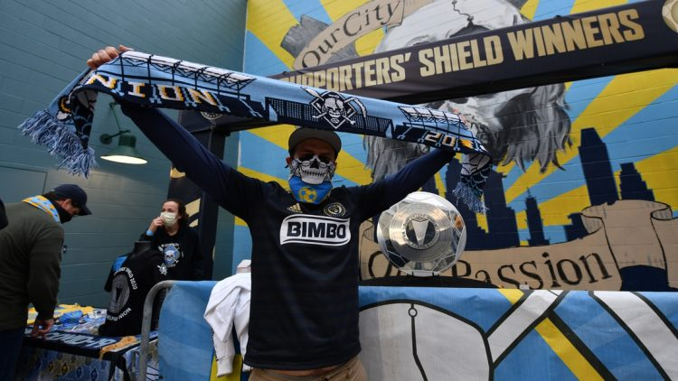 Apr 24, 2021; Philadelphia, Pennsylvania, USA; A fan poses in front of the Supports' Shield Trophy before the game between Inter Miami CF and the Philadelphia Union at Talen Energy Stadium. Mandatory Credit: Kyle Ross-USA TODAY Sports