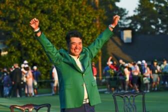 Apr 11, 2021; Augusta, Georgia, USA; Hideki Matsuyama celebrates his victory following the final round of The Masters golf tournament in his green jacket. Mandatory Credit: Michael Madrid-USA TODAY Sports