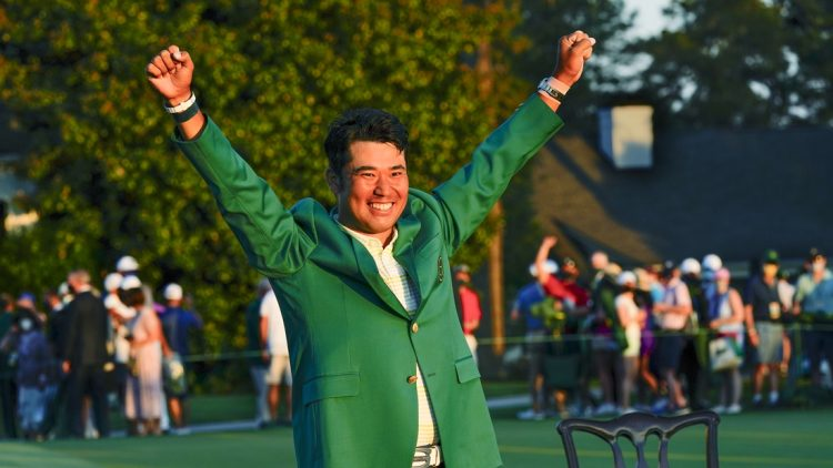 Apr 11, 2021; Augusta, Georgia, USA; Hideki Matsuyama celebrates his victory following the final round of The Masters golf tournament in his green jacket. Mandatory Credit: Michael Madrid-USA TODAY Sports