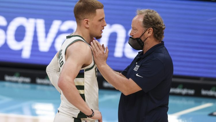 Apr 27, 2021; Charlotte, North Carolina, USA; Milwaukee Bucks coach Mike Budenholzer, right, talks to Milwaukee Bucks guard Donte DiVincenzo (0) during a break in the action against the Charlotte Hornets in the second quarter at Spectrum Center. Mandatory Credit: Nell Redmond-USA TODAY Sports