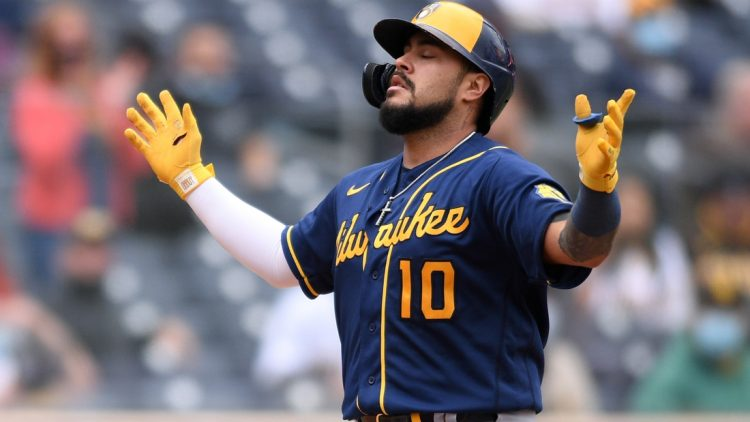 Apr 21, 2021; San Diego, California, USA; Milwaukee Brewers catcher Omar Narvaez (10) celebrates as he approaches home plate after hitting a two-run home run against the San Diego Padres during the sixth inning at Petco Park. Mandatory Credit: Orlando Ramirez-USA TODAY Sports
