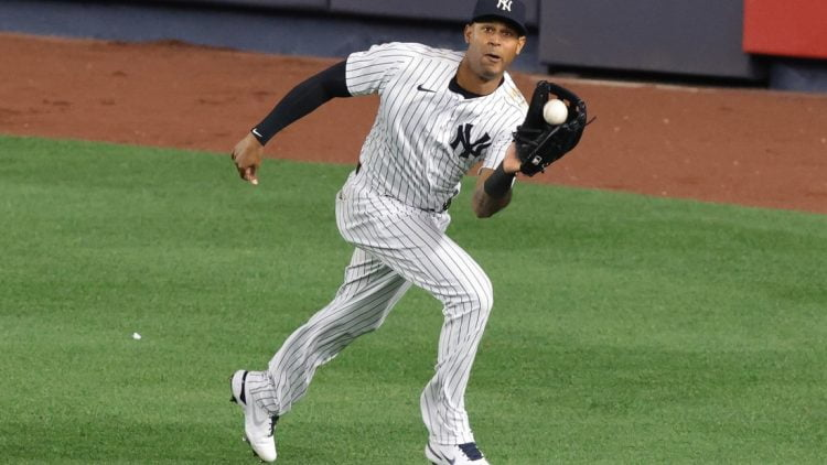 Apr 30, 2021; Bronx, New York, USA; New York Yankees center fielder Aaron Hicks (31) catches the ball for an out during the eighth inning against the Detroit Tigers at Yankee Stadium. Mandatory Credit: Vincent Carchietta-USA TODAY Sports