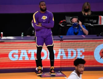 Apr 30, 2021; Los Angeles, California, USA; Los Angeles Lakers forward LeBron James (23) waits to reenter the game during there second quarter against the Sacramento Kings at Staples Center. James returned to the Lakers lineup after recovering from an ankle injury. Mandatory Credit: Robert Hanashiro-USA TODAY Sports