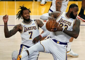 May 2, 2021; Los Angeles, California, USA; Los Angeles Lakers forward LeBron James (23) gets a rebound in front of guard Ben McLemore (7) against the Toronto Raptors  during the second half at Staples Center. Mandatory Credit: Gary A. Vasquez-USA TODAY Sports