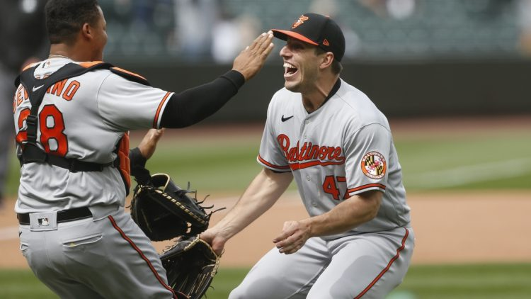 May 5, 2021; Seattle, Washington, USA; Baltimore Orioles starting pitcher John Means (47) and catcher Pedro Severino (28) celebrate following the final out of a no-hit 6-0 victory against the Seattle Mariners at T-Mobile Park. Mandatory Credit: Joe Nicholson-USA TODAY Sports
