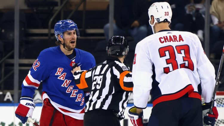 May 5, 2021; New York, New York, USA;  Brendan Smith #42 of the New York Rangers chats with Zdeno Chara #33 of the Washington Capitals during the second period at Madison Square Garden. Mandatory Credit:  Bruce Bennett/POOL PHOTOS-USA TODAY Sports