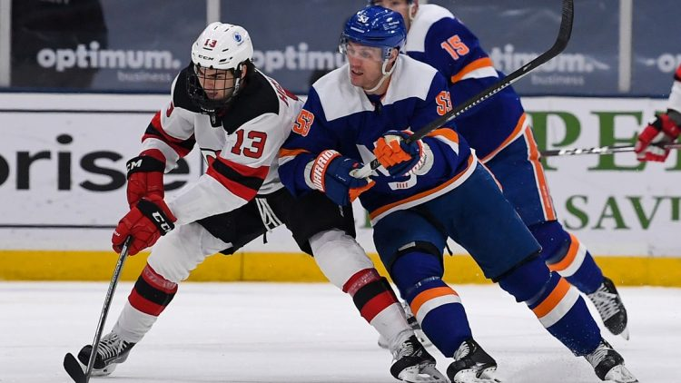 May 6, 2021; Uniondale, New York, USA; New York Islanders center Casey Cizikas (53) defends against New Jersey Devils center Nico Hischier (13) during the first period at Nassau Veterans Memorial Coliseum. Mandatory Credit: Dennis Schneidler-USA TODAY Sports