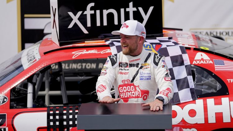 May 8, 2021; Darlington, SC, USA; NASCAR Xfinity Series driver Justin Allgaier celebrates after winning the Steakhouse Elite 200 at Darlington Raceway. Mandatory Credit: Jasen Vinlove-USA TODAY Sports