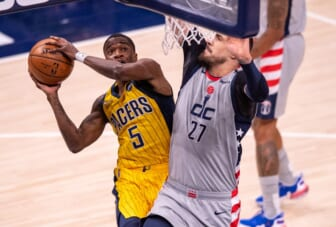 May 8, 2021; Indianapolis, Indiana, USA;  Indiana Pacers guard Edmond Sumner (5) shoots against Washington Wizards center Alex Len (27) during the first half of an NBA basketball game at Bankers Life Fieldhouse. Mandatory Credit: Doug McSchooler-USA TODAY Sports