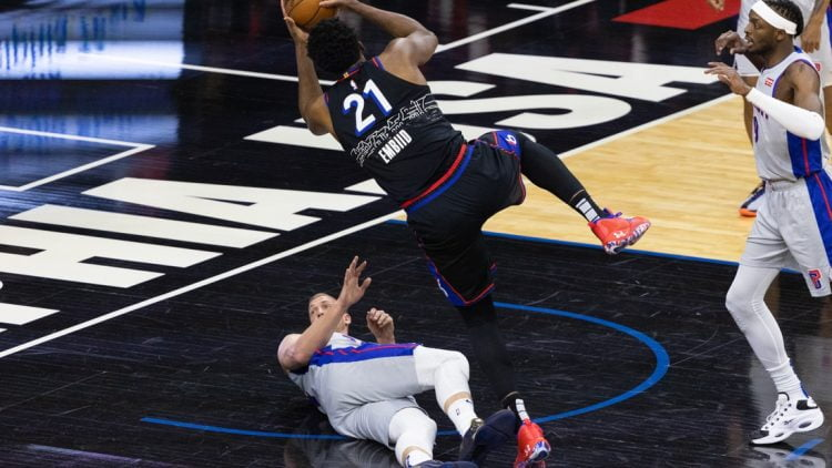 May 8, 2021; Philadelphia, Pennsylvania, USA; Philadelphia 76ers center Joel Embiid (21) collides and fouls Detroit Pistons center Mason Plumlee (24) while driving for a shot during the first quarter at Wells Fargo Center. Mandatory Credit: Bill Streicher-USA TODAY Sports