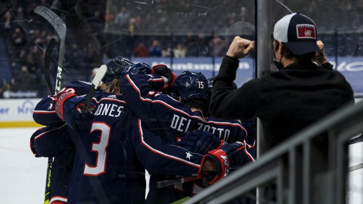 May 8, 2021; Columbus, Ohio, USA; Columbus Blue Jackets center Jack Roslovic (right) celebrates with teammates after scoring a goal against the Detroit Red Wings in the third period at Nationwide Arena. Mandatory Credit: Aaron Doster-USA TODAY Sports