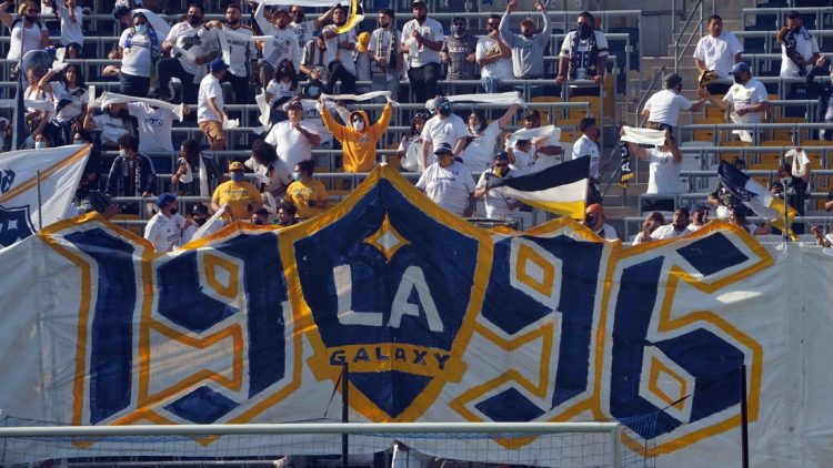 May 8, 2021; Carson, California, USA;  LA Galaxy fans hold a tifo in the first half against the LAFC at Dignity Health Sports Park. Mandatory Credit: Kirby Lee-USA TODAY Sports