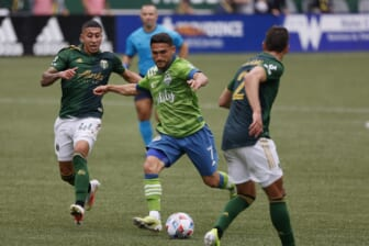 May 9, 2021; Portland, Oregon, USA; Seattle Sounders midfielder Cristian Roldan (7) takes a shot on goal against Portland Timbers midfielder Marvin Lor a (44) during the first half at Providence Park. Mandatory Credit: Soobum Im-USA TODAY Sports