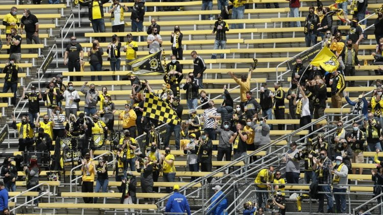 Socially distanced fans celebrate in an MLS game against D.C. United at Crew Stadium in May. News that the team would officially be known as Columbus SC has created a backlash from many fans.  Columbus Crew Sc Vs Dc United