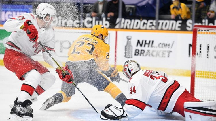 May 10, 2021; Nashville, Tennessee, USA; Nashville Predators right wing Rocco Grimaldi (23) scores a short handed goal past Carolina Hurricanes goaltender Petr Mrazek (34) during the first period at Bridgestone Arena. Mandatory Credit: Christopher Hanewinckel-USA TODAY Sports