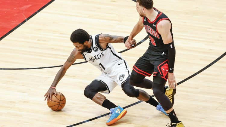 May 11, 2021; Chicago, Illinois, USA; Chicago Bulls guard Zach LaVine (8) fouls Brooklyn Nets guard Kyrie Irving (11) during the first half at United Center. Mandatory Credit: Kamil Krzaczynski-USA TODAY Sports
