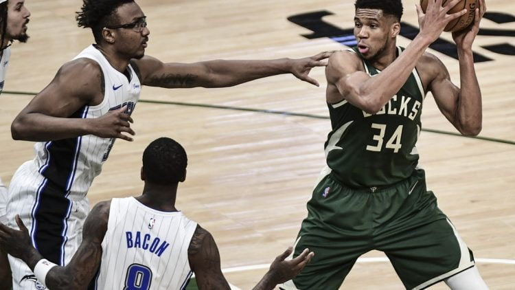 May 11, 2021; Milwaukee, Wisconsin, USA; Milwaukee Bucks forward Giannis Antetokounmpo (34) controls the ball against Orlando Magic center Wendell Carter Jr. (34) during the second quarter at Fiserv Forum. Mandatory Credit: Benny Sieu-USA TODAY Sports