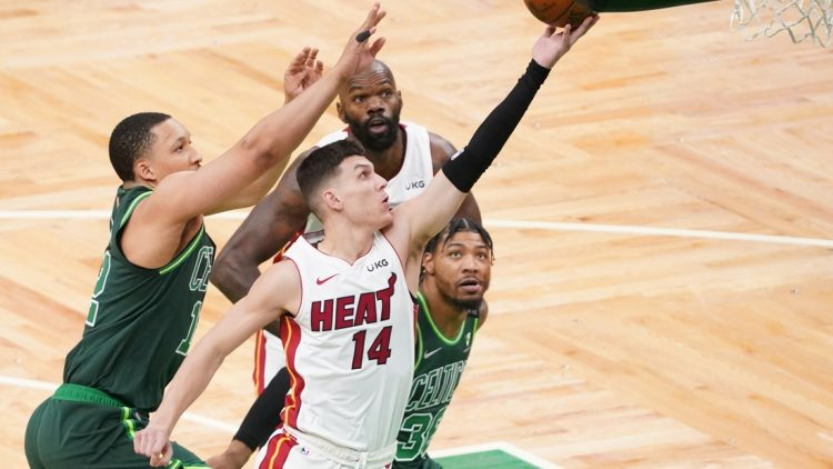 May 11, 2021; Boston, Massachusetts, USA; Miami Heat guard Tyler Herro (14) drives to the basket against the Boston Celtics in the first quarter at TD Garden. Mandatory Credit: David Butler II-USA TODAY Sports