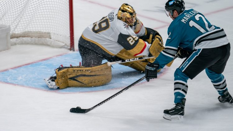 May 12, 2021; San Jose, California, USA; San Jose Sharks center Patrick Marleau (12) shoots the puck against Vegas Golden Knights goaltender Marc-Andre Fleury (29) during the first period at SAP Center at San Jose. Mandatory Credit: Neville E. Guard-USA TODAY Sports
