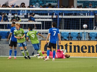May 12, 2021; San Jose, California, USA; San Jose Earthquakes goalkeeper JT Marcinkowski (1) lays on the ground as Seattle Sounders FC players celebrate a goal during the first half at PayPal Park. Mandatory Credit: Kelley L Cox-USA TODAY Sports