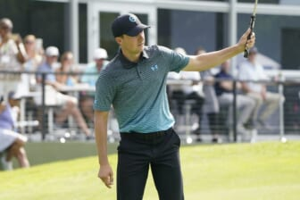 May 15, 2021; McKinney, Texas, USA; Jordan Spieth reacts on his eagle shot on the 18th green during the third round of the Byron Nelson golf tournament. Mandatory Credit: Jim Cowsert-USA TODAY Sports