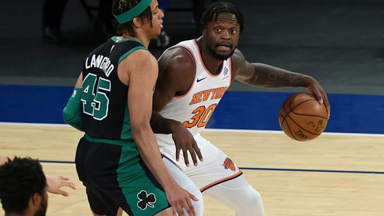 May 16, 2021; New York, New York, USA; New York Knicks forward Julius Randle (30) dribbles as Boston Celtics guard Romeo Langford (45) defends during the first quarter at Madison Square Garden. Mandatory Credit: Vincent Carchietta-USA TODAY Sports