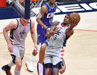 May 16, 2021; Washington, District of Columbia, USA; Washington Wizards guard Bradley Beal (3) shoots as Charlotte Hornets forward Miles Bridges (0) looks on during the second quarter at Capital One Arena. Mandatory Credit: Brad Mills-USA TODAY Sports