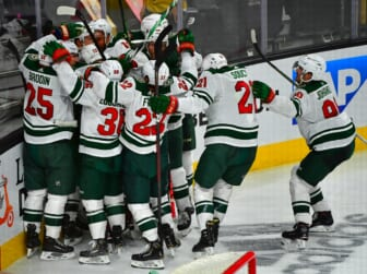 May 16, 2021; Las Vegas, Nevada, USA; Minnesota Wild players celebrate after Minnesota Wild center Joel Eriksson Ek (14) scored an overtime goal to defeat the Vegas Golden Knights 1-0 in game one of the first round of the 2021 Stanley Cup Playoffs at T-Mobile Arena. Mandatory Credit: Stephen R. Sylvanie-USA TODAY Sports