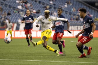 May 16, 2021; Foxborough, Massachusetts, USA; Columbus Crew forward Gyasi Zardes (11) lets go with a shot against the New England Revolution during the first half at Gillette Stadium. Mandatory Credit: Winslow Townson-USA TODAY Sports