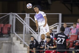 May 16, 2021; Washington, DC, USA; Orlando City defender Joao Moutinho (4) heads the ball against D.C. United during the first half of the match at Audi Field. Mandatory Credit: Scott Taetsch-USA TODAY Sports