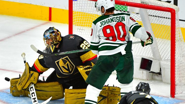 May 18, 2021; Las Vegas, Nevada, USA;Vegas Golden Knights goaltender Marc-Andre Fleury (29) blocks a shot as Minnesota Wild center Marcus Johansson (90) stands in the crease during the third period of game two of the first round of the 2021 Stanley Cup Playoffs at T-Mobile Arena. Mandatory Credit: Stephen R. Sylvanie-USA TODAY Sports